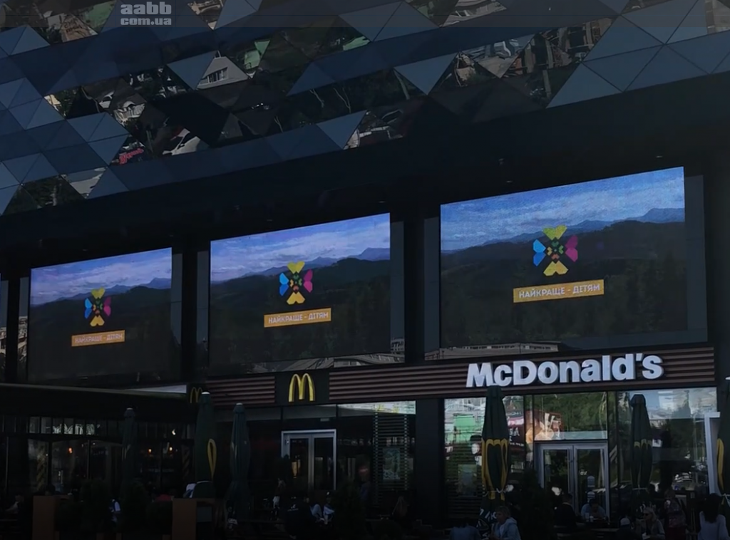 Advertising on the media facade of the shopping center Ocean Plaza advertising Bukovel