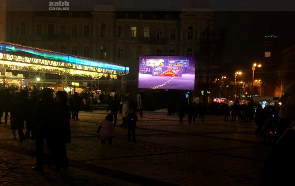 Advertising Milka on a video screen on Sophia Square Kyiv